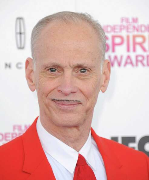 Filmmaker John Waters arrives.