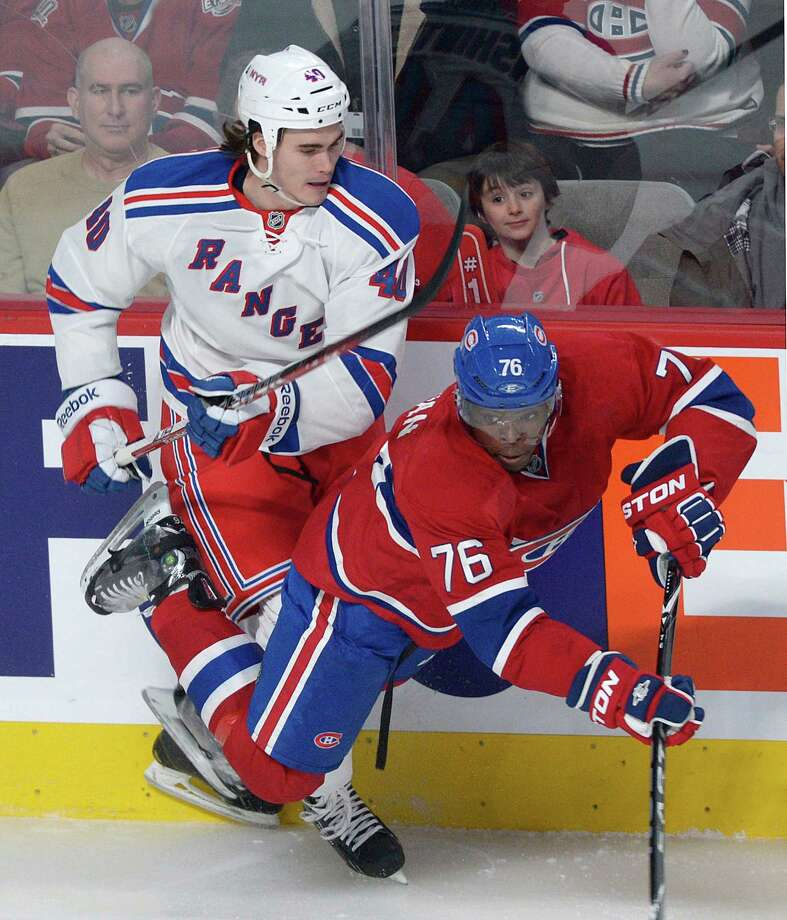 Montreal Canadiens' P.K. Subban (76) collides with New York Rangers' Brandon Mashinter during the first period  of an NHL hockey game in Montreal, Saturday, Feb. 23, 2013. (AP Photo/The Canadian Press, Graham Hughes) Photo: Graham Hughes