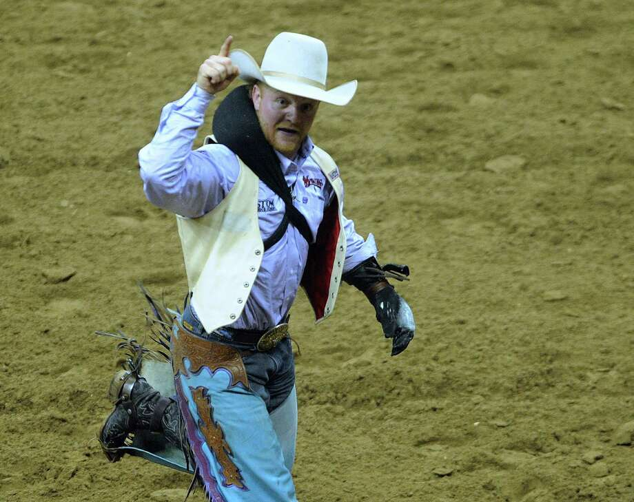 Bareback bronc rider J.R. Vezain celebrates after scoring an 88 in the bareback bronc riding competition at the San Antonio Stock Show & Rodeo on Saturday, Feb. 23, 2013. Photo: Billy Calzada, San Antonio Express-News / San Antonio Express-News