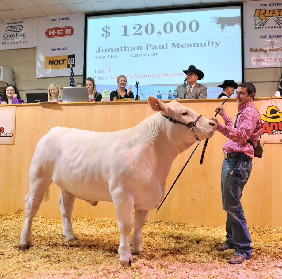"Jonathan Mcanulty smiles as his grand champion market steer, Eminem, fetched a record $120,000 at the 64th annual San Antonio Stock Show and Rodeo Auction on Friday at the AT&T Center. McAnulty, 17, a junior at Cameron Yoe High School, raised M&M from birth. ""I've put in countless hours,"" Mcanulty said. ""He (Eminem) has never given me any trouble."" Photo: Robin Jerstad / For The San Antonio Express-News"