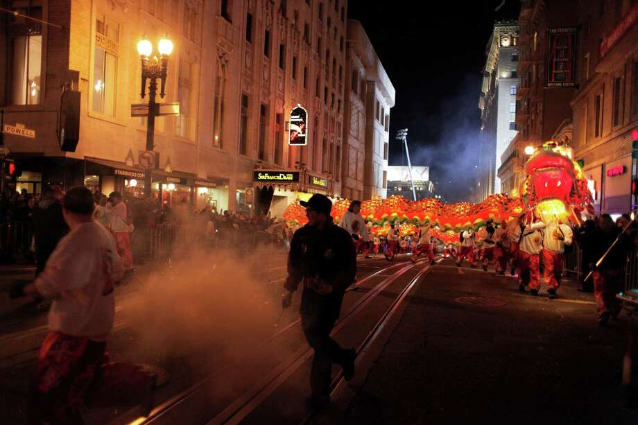 The final dragon of the Chinese New Year Parade makes its way down Powell St. on Saturday, Feb. 23. Photo: James Tensuan / The Chronicle / ONLINE_YES
