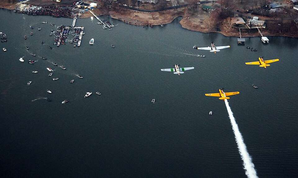 A formation of T-6 aircraft fly over during the playing of the national anthem during the Bassmaster