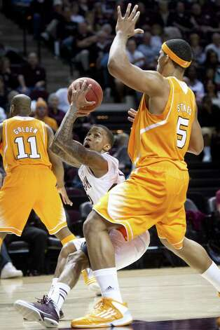 Tennessee's Jarnell Stokes stops A&M's Fabyon Harris in the first half. Stokes had his 12th double-double this season with 20 points and 16 rebounds. Photo: Stuart Villanueva / Bryan-College Station Eagle