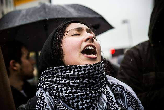 NEW YORK, NY - FEBRUARY 23:  A woman participates in a chant during a march against police stop-and-frisk tactics on February 23, 2013 in New York City. The march, which consisted of a few hundred people, started in the Bronx borough of New York and marched into the Harlem neighborhood of Manhattan.  (Photo by Andrew Burton/Getty Images) Photo: Andrew Burton, Getty Images