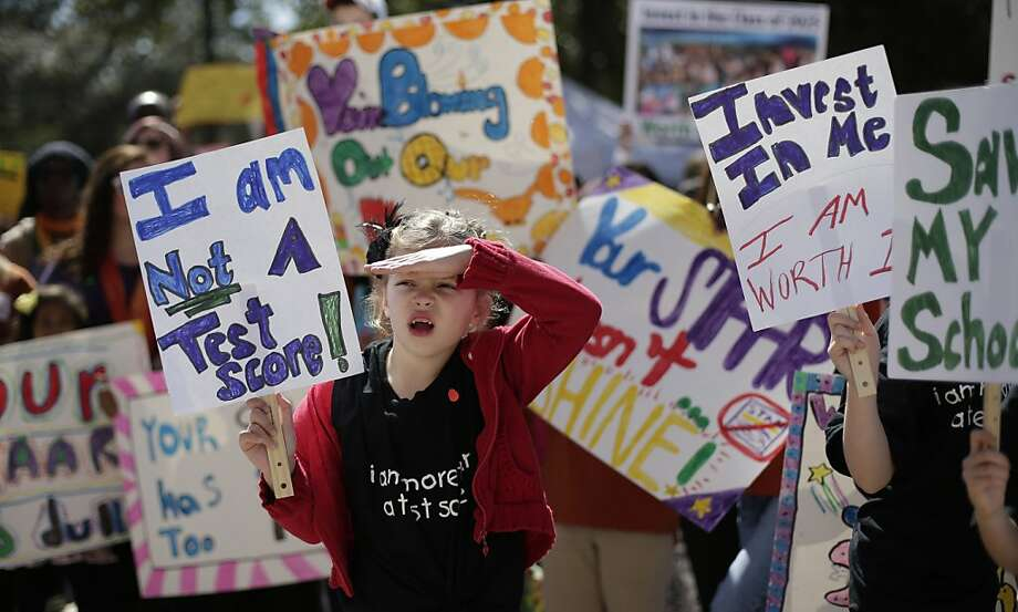Cate Foughty, 6, of Frisco, Texas, takes part in a rally for Texas public schools at the state Capitol, Saturday, Feb. 23, 2013, in Austin, Texas. About 2,000 teachers, students, parents and school administrators rallied at the state Capitol, demanding that the Legislature reverse $5.4 billion in cuts to public education amid new data that Texas now spends less per-pupil than almost anywhere else in America.(AP Photo/Eric Gay) Photo: Eric Gay, Associated Press