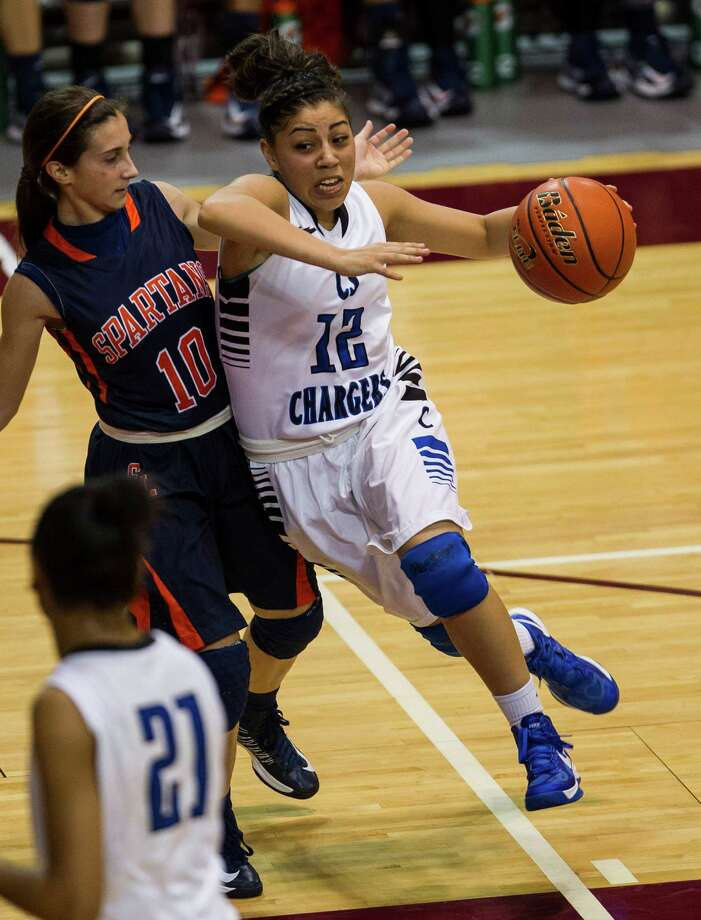 Seven Lakes' Ally Barrios, left, can't stop Clear Springs' Joann Lira, who drives to the basket in the second quarter of Saturday's Class 5A Region III final. Photo: Nick De La Torre, Staff / © 2013 Houston Chronicle