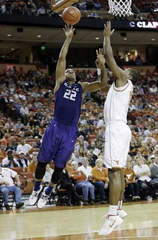 Kansas State's Rodney McGruder (22) shoots around Texas' Jonathan Holmes during the second half. McGruder led the Wildcats with 20 points. Photo: Eric Gay / Associated Press