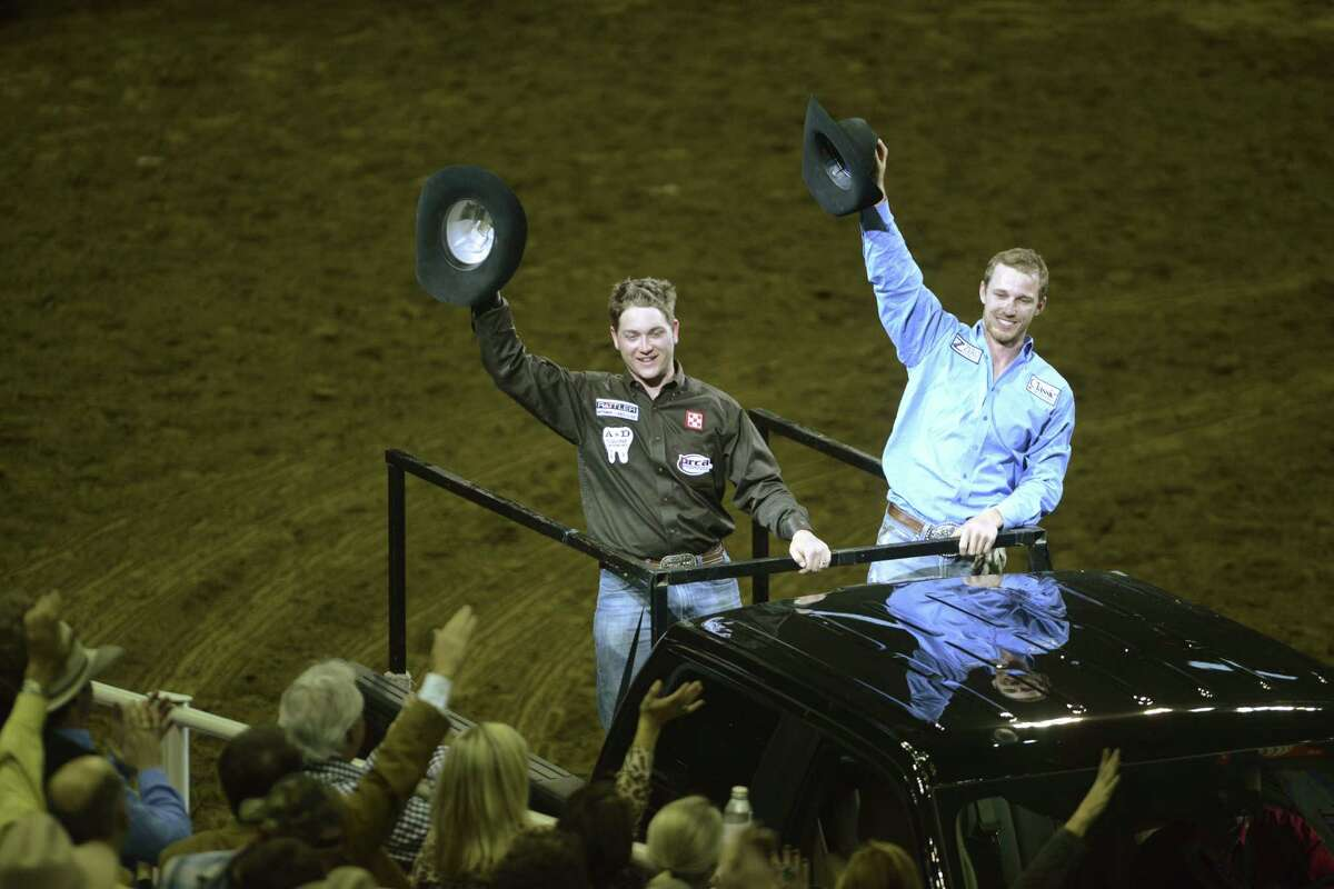 Drew Horner (left) and Buddy Hawkins acknowledge the fans after winning the team roping competition.