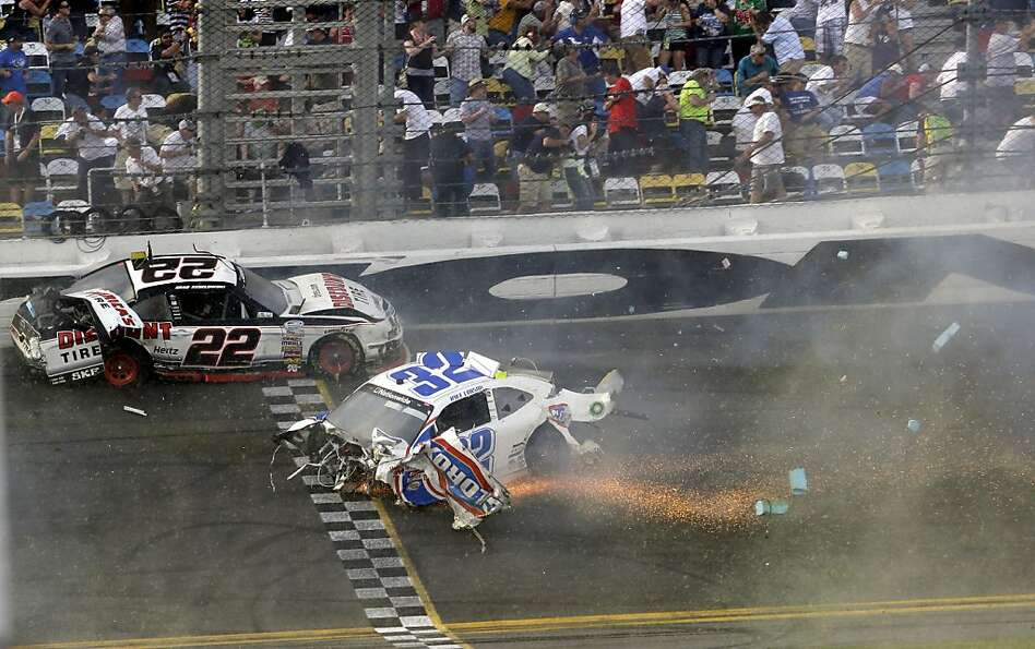 Brad Keselowski (22) and Kyle Larson (32) slide across the finish line after they were involved in a