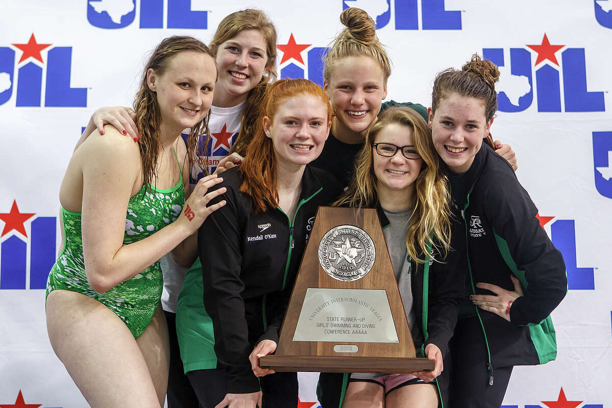 Reagan's Sarah Gibson (from left) Alyssa Adams, Kendall O'Kane, Mary Margaret Soderberg, Madison Lamey and Kristina Damaschafsky celebrate with their girls state runner-up trophy at the the finals of the 5A UIL Swimming & Diving State Meet at the Jamail Texas Swim Center in Austin on Saturday, Feb 23, 2013. MARVIN PFEIFFER/ mpfeiffer@express-news.net