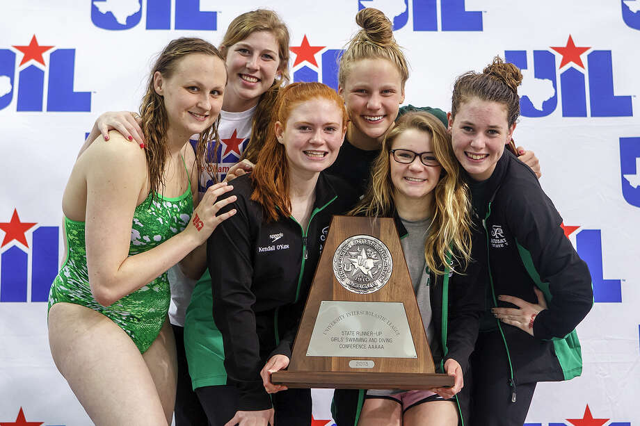 Reagan's Sarah Gibson (from left) Alyssa Adams, Kendall O'Kane, Mary Margaret Soderberg, Madison Lamey and Kristina Damaschafsky celebrate with their girls state runner-up trophy at the the finals of the 5A UIL Swimming & Diving State Meet at the Jamail Texas Swim Center in Austin on Saturday, Feb 23, 2013.  MARVIN PFEIFFER/ mpfeiffer@express-news.net Photo: MARVIN PFEIFFER, Express-News / Express-News 2013