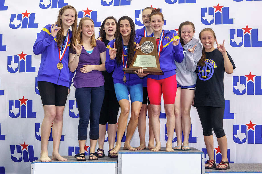 The Alamo Heights girls swim team celebrates on the podium with their state runner-up trophy at the the finals of the 4A UIL Swimming & Diving State Meet at the Jamail Texas Swim Center in Austin on Saturday, Feb 23, 2013.  MARVIN PFEIFFER/ mpfeiffer@express-news.net Photo: MARVIN PFEIFFER, Express-News / Express-News 2013