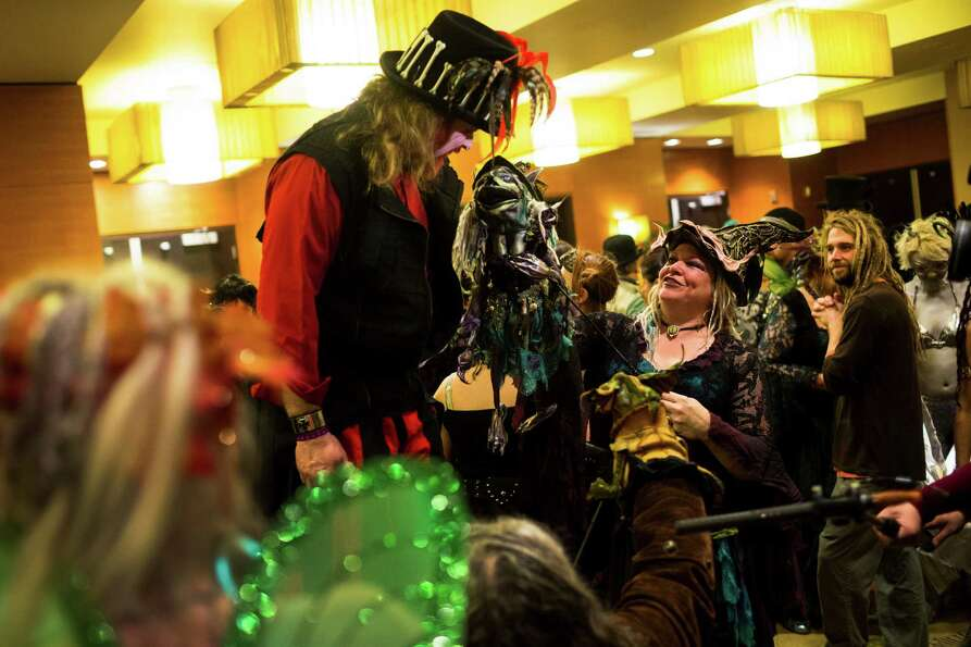 Crowds of costume-clad attendees posed for pictures and compared articles of clothing during FaerieC