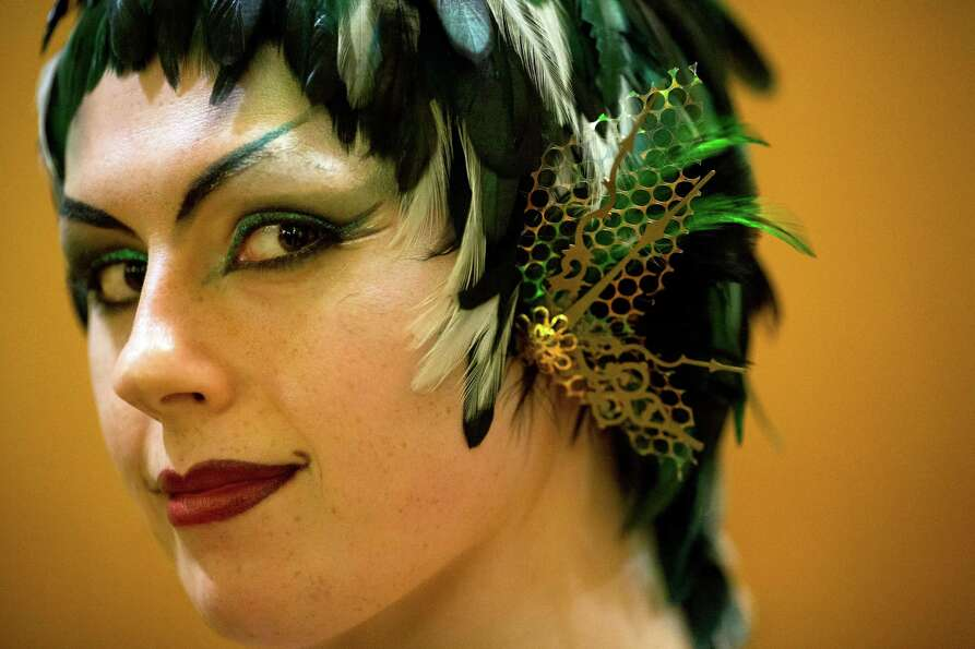 Attendees pose for portraits during FaerieCon West Saturday, Feb. 23, 2013, in Seattle, Wash. Crowds