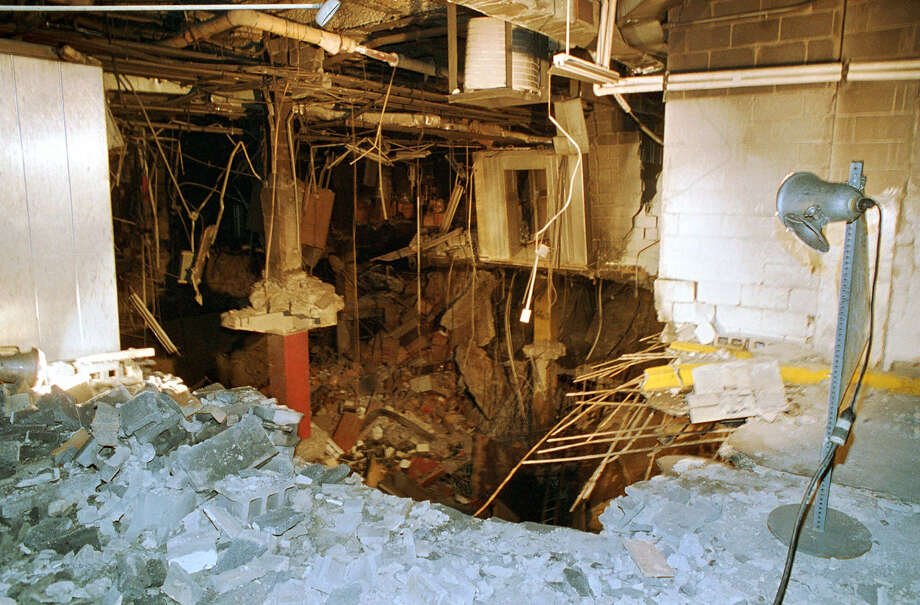 FILE. In this file photo of Feb. 27, 1993, a crater is exposed in an underground parking garage of New York's World Trade Center the day after an explosion tore through it. Twenty years ago next week, a group of terrorists blew up explosives under one of the towers, killing six people and ushering in an era of terrorism on American soil.(AP Photo/Richard Drew, File) Photo: RICHARD DREW