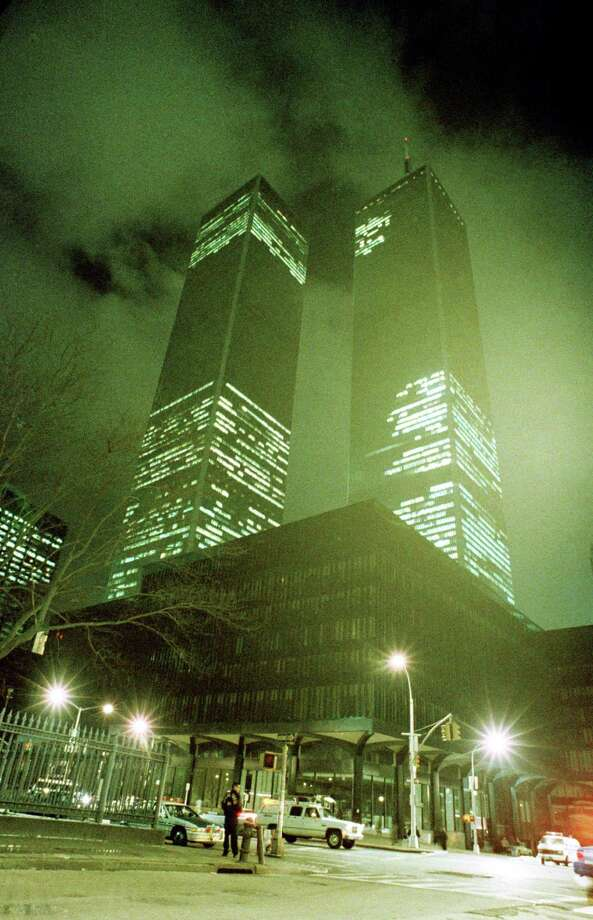 FILE. In this file photo of Feb. 26, 1993, the twin towers of the World Trade Center in New York City are shown in the aftermath of an explosion earlier that day. Twenty years ago next week, a group of terrorists blew up explosives in an underground parking garage under one of the towers at the World Trade Center, killing six people and ushering in an era of terrorism on American soil.  (AP Photo/Ron Frehm, File) Photo: RON FREHM