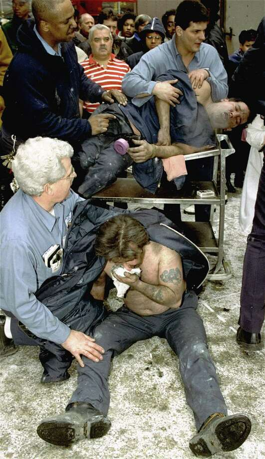 FILE - In this file photo of Feb. 26, 1993, Victims of a fire at the World Trade Center in New York are treated at the scene after an explosion rocked the complex. Twenty years ago next week, a group of terrorists blew up explosives in an underground parking garage under one of the towers, killing six people and ushering in an era of terrorism on American soil. (AP Photo/Marty Lederhandler, File) Photo: MARTY LEDERHANDLER