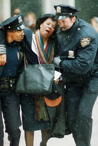 FILE - In this file photo of Feb. 26, 1993, two New York City police officers help an injured women away from the scene of the World Trade Center explosion. Twenty years ago next week, a group of terrorists blew up explosives in an underground parking garage under one of the towers, killing six people and ushering in an era of terrorism on American soil.  (AP Photo/Joe Tabacca, File) Photo: JOE TABACCA