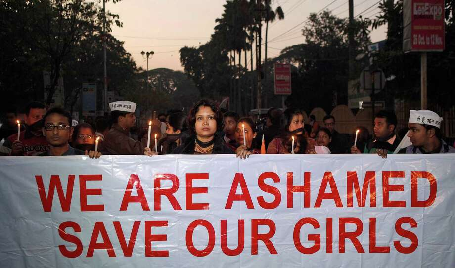 In this Saturday, Dec. 29, 2012 file photo, Indian women participate in a silent procession to mourn the death of a New Delhi gang rape victim, in Gauhati, India. Only two months later, angry villagers in western India threatened Saturday to resume a highway blockade unless police show progress in the search for suspects in the rape and killing of three young sisters. The girls' bodies were found Feb. 16 in a village well in Bhandara district of Maharashtra state after they had gone missing from school two days earlier. According to news reports, their mother has said the girls were 6, 9 and 10 years old. Photo: AP