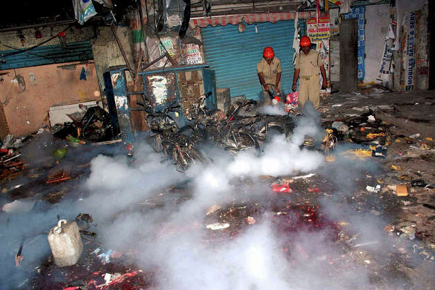 Firemen try to douse the fire at the site of a bomb blast in Hyderabad, India, Thursday. A pair of bombs exploded Thursday evening in a crowded shopping area in the southern Indian city of Hyderabad, killing several people and wounding many in the worst bombing in the country in more than a year, officials said. Photo: AP