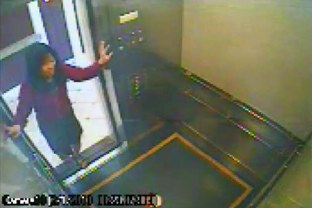 This still image taken from a security video was released on Feb. 13 by the Los Angeles Police Department in connection with the search for 21-year-old missing Canadian tourist Elisa Lam. In this image, a woman believed to be Lam enters an elevator in the Cecil Hotel in downtown Los Angeles on Thursday, Jan. 31, the last day she was seen alive. A maintenance worker at the hotel found Lam's body in a water cistern on the building's roof on Feb. 19, more than two weeks after she had gone missing. Photo: AP