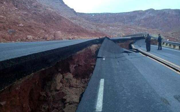 "This photo provided by the Arizona Department of Transportation shows the buckling of U.S. 89, about 25 miles south of Page, Ariz., Wednesday. The Arizona Department of Transportation is rerouting motorist off the heavily traveled highway between Arizona and Utah on to other roadways. ADOT says what caused a 150-foot section of pavement to buckle is not related to the weather and might be what ADOT calls a ""geologic event."" Photo: AP"