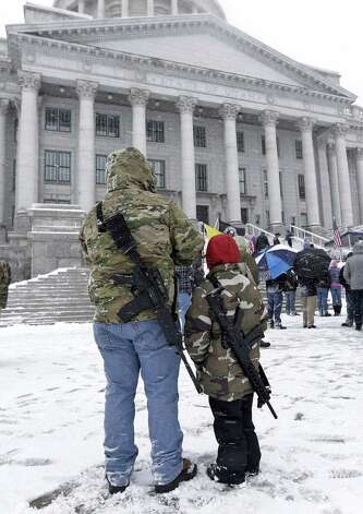 Gunright activist Clint McQueen and his son Chance hold their rifles as they gather with others at the Utah State Capitol during a National Day of Resistance Saturday in Salt Lake City, Utah. The activist were there to support the U.S. Constitution and the 2nd Amendment. Photo: AP