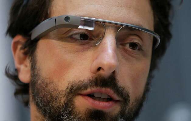 "Google co-rounder Sergey Brin wears Google Glass glasses at an announcement for the Breakthrough Prize in Life Sciences at Genentech Hall on UCSF's Mission Bay campus in San Francisco, Wednesday, Feb. 20, 2013. Google is giving more people a chance to pay $1,500 for a pair of the Internet-connected glasses that the company is touting as the next breakthrough in mobile computing. The product, dubbed ""Google Glass,"" will be offered to ""bold, creative individuals"" selected as part of a contest announced Wednesday. Participants must live in the U.S. and submit an application of up to 50 words explaining what they would do with the Google Glass technology. Photo: AP"