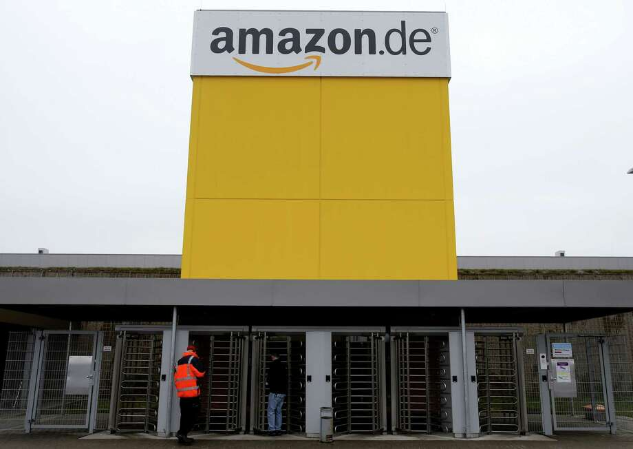 The internet trader Amazon main entrance is seen at the company's logistic center in Rheinberg, Germany, Tuesday. Amazon is in trouble after a TV report on inhuman working conditions in Germany. Photo: AP