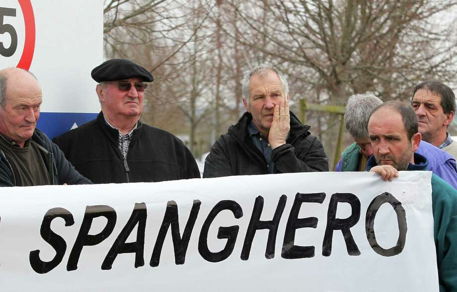 French farmers hold a placard as they demonstrate in support of the cooperative Lur Berri group, which includes Spanghero society, which is identified by French Consumer Affairs Minister Benoit Hamon as a major culprit in the use of horse meat in food products, in Aicirits,  southwestern France, Monday.  Tests have found horsemeat in school meals, hospital food and restaurant dishes in Britain, as the scandal over adulterated meat spread beyond frozen supermarket products, and Britain's Environment Secretary Owen Paterson called for a Europe-wide overhaul of food testing in the wake of the ongoing horsemeat scandal.   The Spanghero company denied wrongdoing. Photo: AP