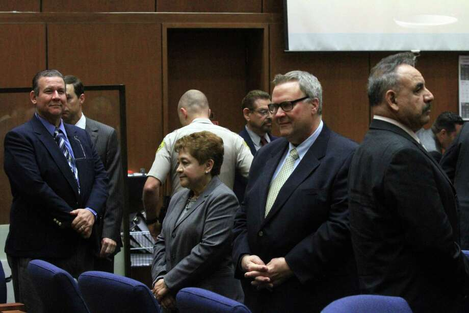 Former Bell council members Luis Artiga, left, Teresa Jacobo, George Mirabal, George Cole and former Mayor Oscar Hernandez stand in respect of jury as closing arguments session breaks for lunch on Wednesday in Los Angeles. The city of Bell was nearly driven to bankruptcy by the outrageous actions of six former officials who are facing charges of misappropriating funds, Prosecutor Ed Miller said. Photo: AP
