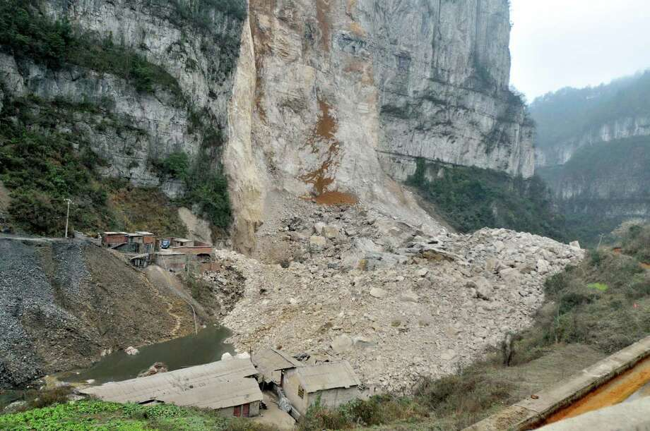 In this photo released by China's Xinhua News Agency, rocks pile up after a landslide in Longchang Township in the city of Kaili, southwest China's Guizhou Province, Monday. Five people, including two children, were buried after the disastert, Xinhua said. (AP Photo/Xinhua, Xu Peiliang) Photo: AP