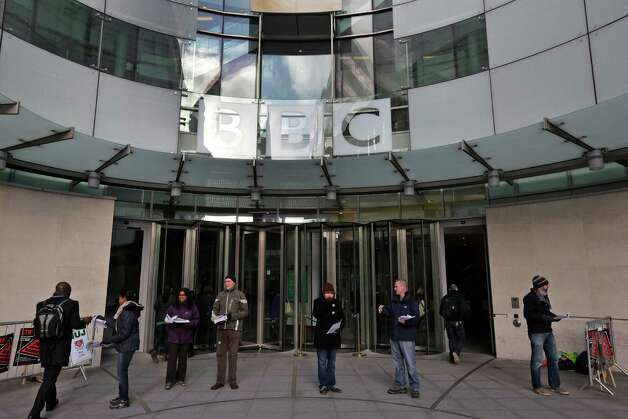 BBC journalists mount picket lines after launching a 24-hour strike in a row over jobs, outside the BBC Broadcasting House, in central London, Monday. Photo: AP