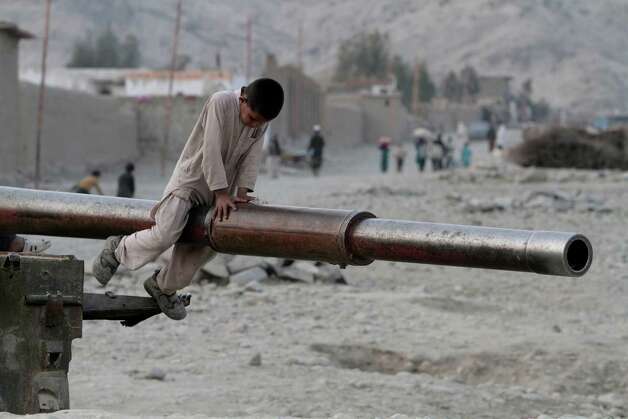 An Afghan child plays on the barrel of a Soviet tank in the Behsood district of Jalalabad, Afghanistan, Monday. Despite being a mineral-rich country, four decades of war have left Afghanistan as one of the least developed countries in the world and highly dependent on foreign aid. Photo: AP