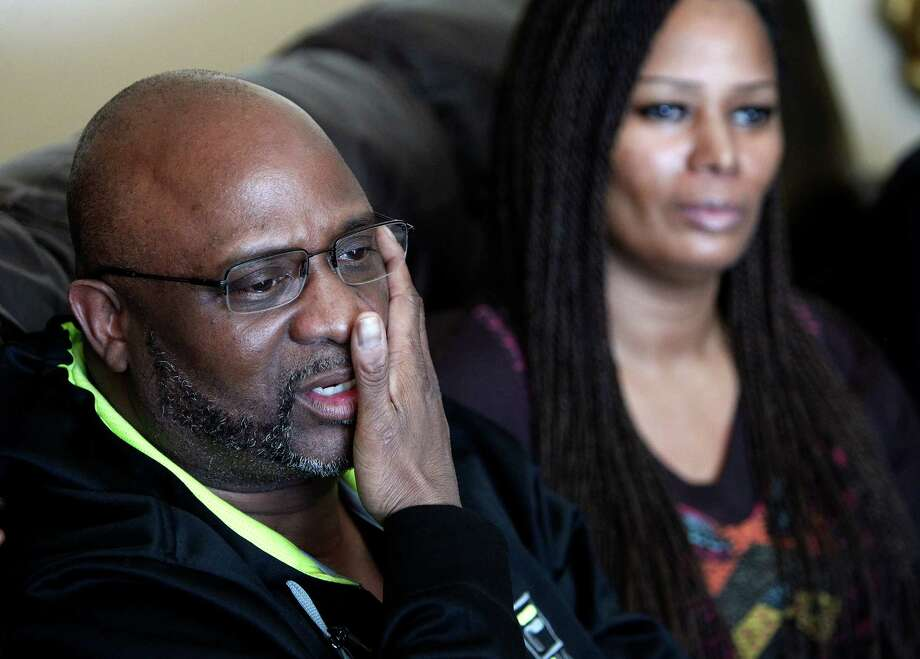 Kenneth Cherry Sr., left, wipes his face during a news conference in Las Vegas on Saturday regarding the death of his son Kenny Cherry, as his sister Becky Cherry watches. Kenneth Cherry Jr., was driving a Maserati that was peppered by gunfire before it sped through a red light and smashed into a taxi driven by Michael Boldon carrying passenger Sandra Sutton-Wasmund. All three involved in the crash were killed and the  coroner said Cherry died of a gunshot to the chest. Photo: AP