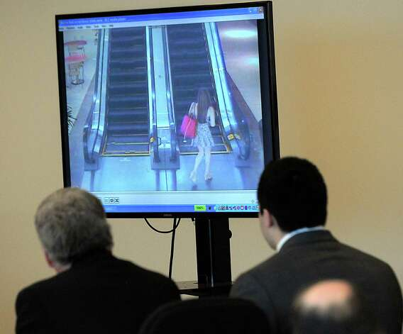 Nathaniel Fujita, right, and defense attorney William Sullivan watch July 3, 2011 security camera video footage of Lauren Astley ascending an escalator at the Natick Mall, in Natick, Mass., during Fujita's murder trial in Middlesex Superior Court in Woburn, Mass., Tuesday. Fujita is accused of killing his ex-girlfriend, Lauren Astley in July 2011. Photo: AP
