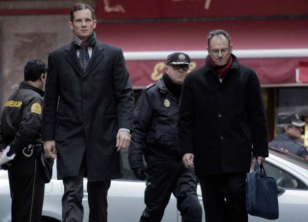 Inaki Urdangarin, the Duke of Palma, left, arrives with his lawyer, right, at a courthouse in Palma de Mallorca, Spain, Saturday. The Spanish king's son-in-law arrived at court Saturday to be questioned by a judge about allegations he and a partner funneled millions of euros to companies they controlled. Urdangarin has not been charged with a crime. But he has been called to answer questions at the courthouse Saturday about whether he used his high-profile status to secure lucrative deals for a nonprofit foundation he ran and then fraudulently diverted money for personal gain. Photo: AP