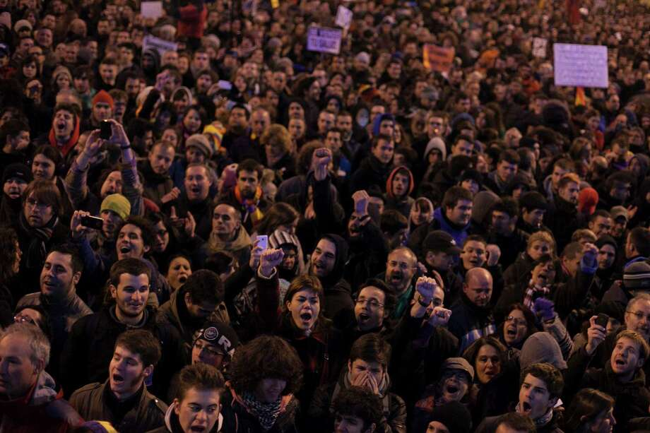 "Demonstrators gather in a square near to the parliament during a protest in Madrid, Spain, on Saturday. Thousands of people are marching on Spain's parliament to protest austerity measures imposed by the government. Saturday's protest comes on the 32nd anniversary of a failed attempt by the armed forces to overthrow the government. Several protest groups joined forces under a single slogan called ""Citizens' Tide, 23F,"" referring to the Feb. 23, 1981 attack by armed forces on Spain's parliament. Photo: AP"