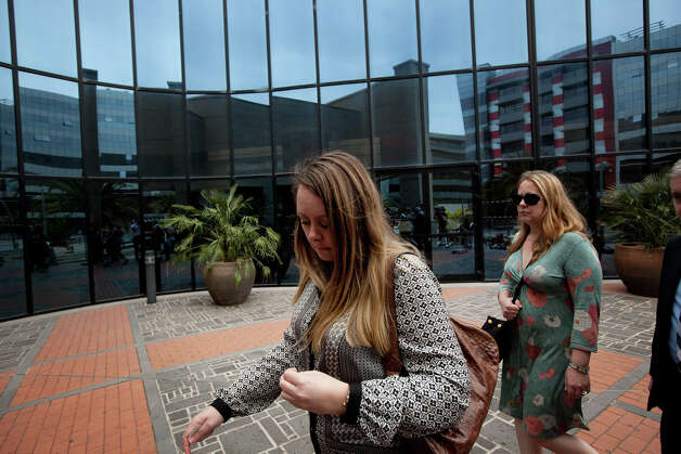Sarah, left and Sam, right, daughters of Jennifer Mills-Westley, who was allegedly killed by Bulgarian Deyan Valentinov, arrive at the court in Santa Cruz de Tenerife in the Canary Islands, Spain, Monday. The trial opened Monday of a Bulgarian man who allegedly beheaded a British woman with a carving knife in a random attack inside a supermarket on the Spanish resort island of Tenerife in the Canary Islands. Prosecutors demand he should be sentenced to 20 years in a mental asylum because he has chronic paranoid schizophrenia. Photo: AP