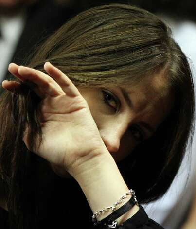 Olympic athlete Oscar Pistorius' sister Aimee Pistorius looks on during his bail hearing at the magistrate court in Pretoria, South Africa, on Friday. Pistorius was granted bail in the Pretoria Magistrate's Court on Friday. Photo: AP
