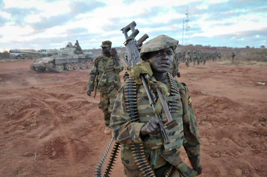 Ugandan soldiers, operating under the African Union Mission in Somalia (AMISOM), advance on Saturday