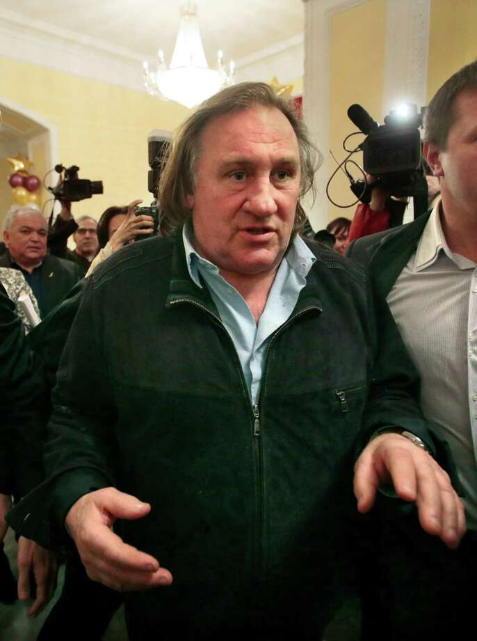 French actor Gerard Depardieu arrives for the opening ceremony of the Illusion movie theater after its restoration in Moscow, Russia, Friday. President Vladimir Putin granted Depardieu Russian citizenship last month and on Saturday he is set to get registered as a resident of the city of Saransk. Photo: AP