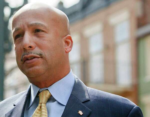 Former New Orleans Mayor Ray Nagin arrives at the Hale Boggs Federal Building and U.S. District Courthouse to appear in federal court for an arraignment on public corruption charges in New Orleans, Wednesday. Nagin pleaded not guilty Wednesday to charges he accepted more than $200,000 in bribes plus free trips and other gratuities in exchange for helping contractors secure millions of dollars in work for the city. U.S. Magistrate Sally Shushan set Nagin's bond at $100,000 during his arraignment on charges that include bribery, wire fraud and filing false tax returns. She also set a preliminary trial date of April 29. The charges against Nagin are the product of a City Hall corruption investigation that already has resulted in guilty pleas by two former city officials and two businessmen and a prison sentence for a former city vendor. His arraignment marked a rare public appearance for Nagin, who now lives in Frisco, Texas, and has kept a low-profile since he left office in 2010. Photo: AP