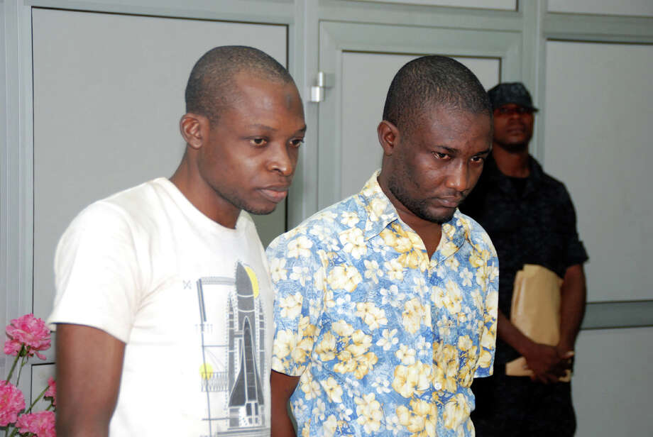 "Saheed Aderemi Adewumi, left, and Sulaiman Olayinka Saka, right,  two suspected terrorists paraded to journalists by Nigeria's secret police in Abuja, Nigeria, Wednesday.  Nigeria's secret police said Wednesday they have broken up a terrorist group backed by ""Iranian handlers"" who wanted to assassinate a former military ruler and gather intelligence about locations frequented by Americans and Israelis. Photo: AP"
