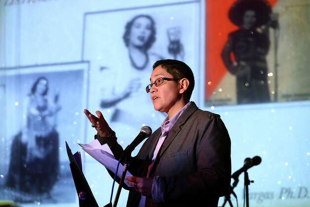Dr. Deborah Vargas speaks as the life of Eva Garza is remembered at the Esparanza Center on February 23, 2013. Photo: TOM REEL