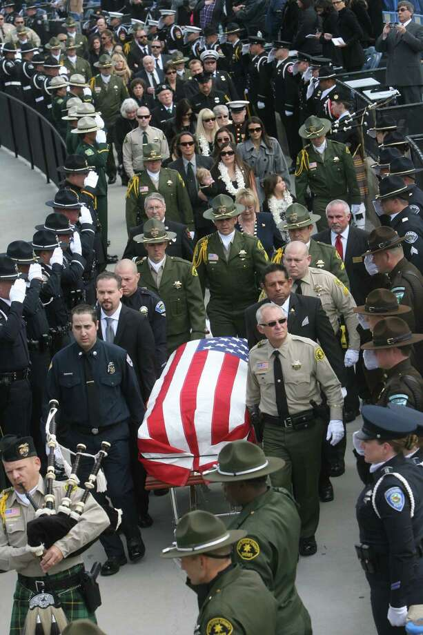 Funeral services for fallen San Bernardino Sheriff's Det. Jeremiah MacKay at San Manuel Amphitheater on Thursday. Thousands of law enforcement officers from across the Southwest gathered to honor MacKay, who was killed in the violent conclusion of the manhunt for fugitive former police officer Christopher Dorner. Photo: AP