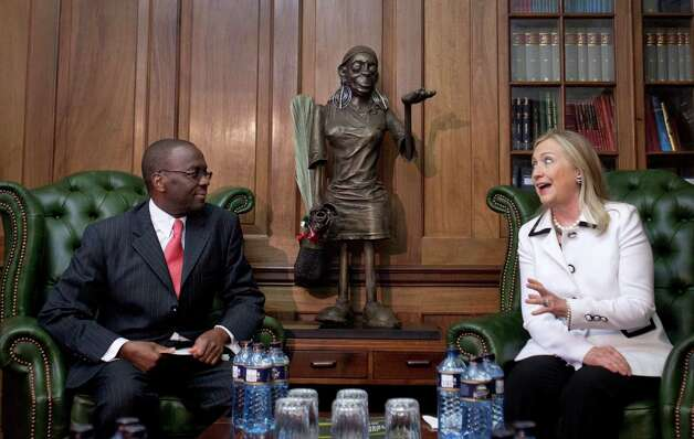 U.S. Secretary of State Hillary Rodham Clinton, right, meets Chief Justice Willy Mutunga at the Supreme Court of Kenya, in Nairobi, Kenya, last year.  Mutunga is making an extraordinary public statement that he will not be cowed by threats and harassment ahead of the country's March 4 election, after receiving a threatening letter warning of dire consequences if the courts rule against the eligibility of two leaders who are facing trial at the International Criminal Court. Photo: AP