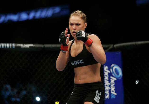 Ronda Rousey gets ready for her UFC 157 women's bantamweight championship mixed martial arts match with Liz Carmouche in Anaheim, Calif., Saturday, Feb. 23, 2013. Rousey won by tapout in the first round. (AP Photo/Jae C. Hong) Photo: Jae C. Hong, Associated Press / AP