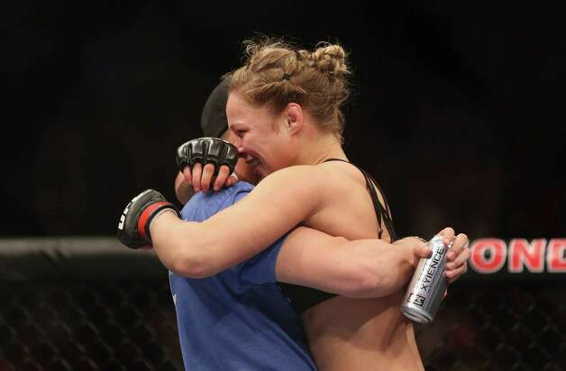 Ronda Rousey celebrates her UFC Bantamweight Title over Liz Carmouche with a member of her team at Honda Center on February 23, 2013 in Anaheim, California. Photo: Jeff Gross, Getty Images / 2013 Getty Images