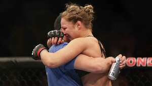 ANAHEIM, CA - FEBRUARY 23:  Ronda Rousey celebrates her UFC Bantamweight Title over Liz Carmouche with a member of her team at Honda Center on February 23, 2013 in Anaheim, California.